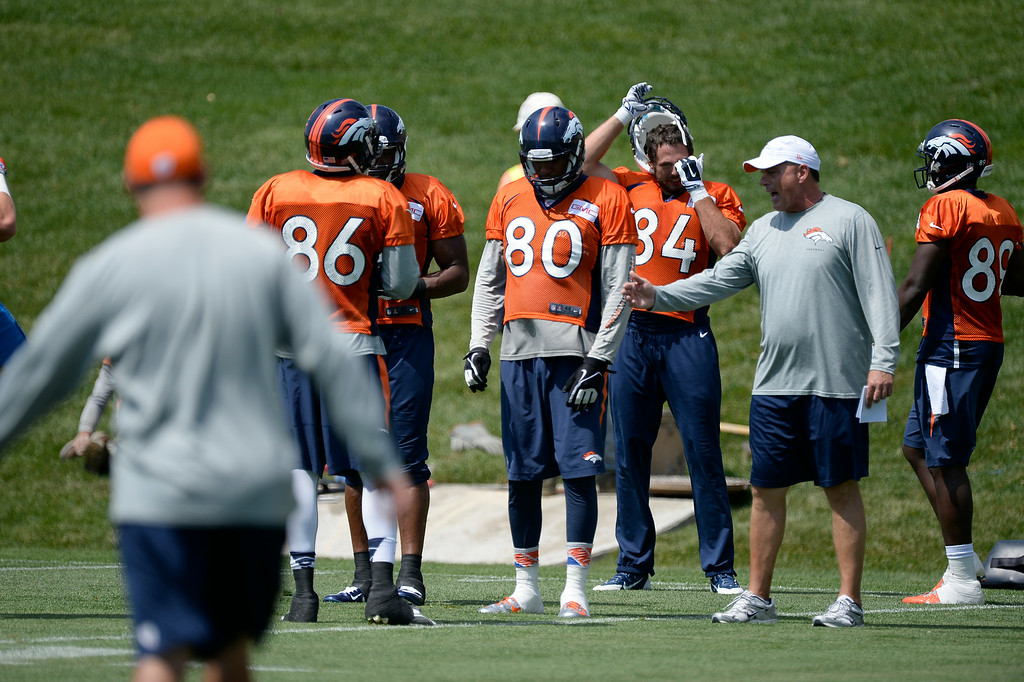 . Denver Broncos tight end Julius Thomas (80) listens to Clancy Barone during day two of the Denver Broncos 2014 training camp July 25, 2014 at Dove Valley. (Photo by John Leyba/The Denver Post)