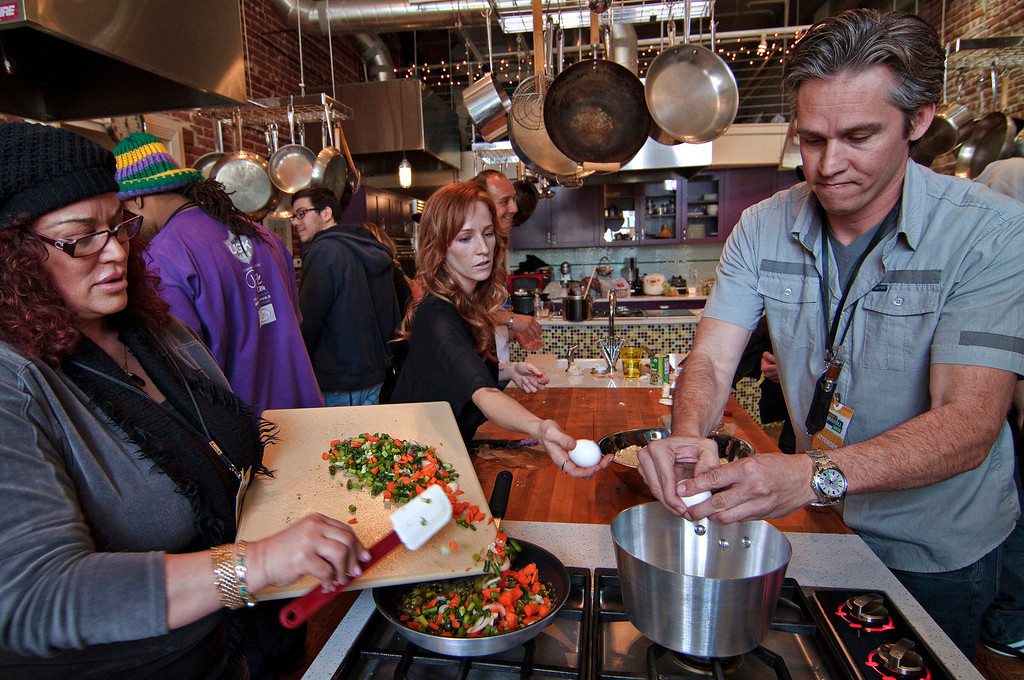 . Chef Dani Fontaine, center, assists participants during a Cannabis cooking class in Denver on Thursday, April 18, 2013. Participants cooked up cannabis-infused quinoa, as well as a granola trail mix. According to organizers, the food infused with cannabis results in a greater and more-consistant THC effect. The class was one of three offered during World Cannabis Week.  (Werner R. Slocum/MCT)