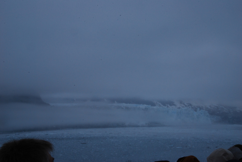 The glacier dramatically emerges from the fog.