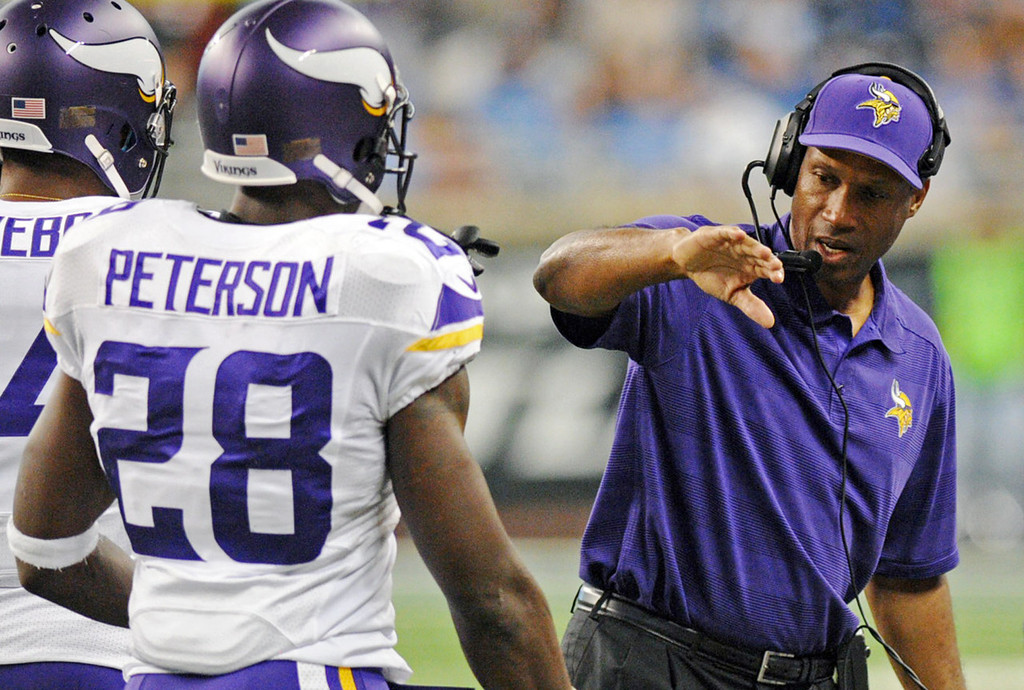 . Vikings running back Adrian Peterson returns to the bench and is congratulated by head coach Leslie Frazier after scoring a touchdown in the second quarter against the Lions.  (Pioneer Press: Chris Polydoroff)