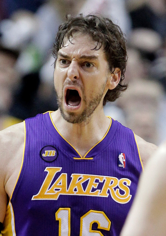 . Los Angeles Lakers forward Pau Gasol, from Spain, reacts after he is called for an offensive foul during the second half of an NBA basketball game against the Portland Trail Blazers in Portland, Ore., Wednesday, April 10, 2013.  Gasol scored 23 points and pulled in seven rebounds as the Lakers won 113-106.(AP Photo/Don Ryan)