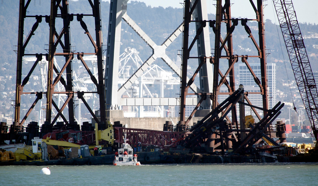 . A barge crane removing falsework from the new Bay Bridge project toppled near Treasure Island on Thursday, Feb. 21, 2013 in San Francisco.  (Karl Mondon/Staff)