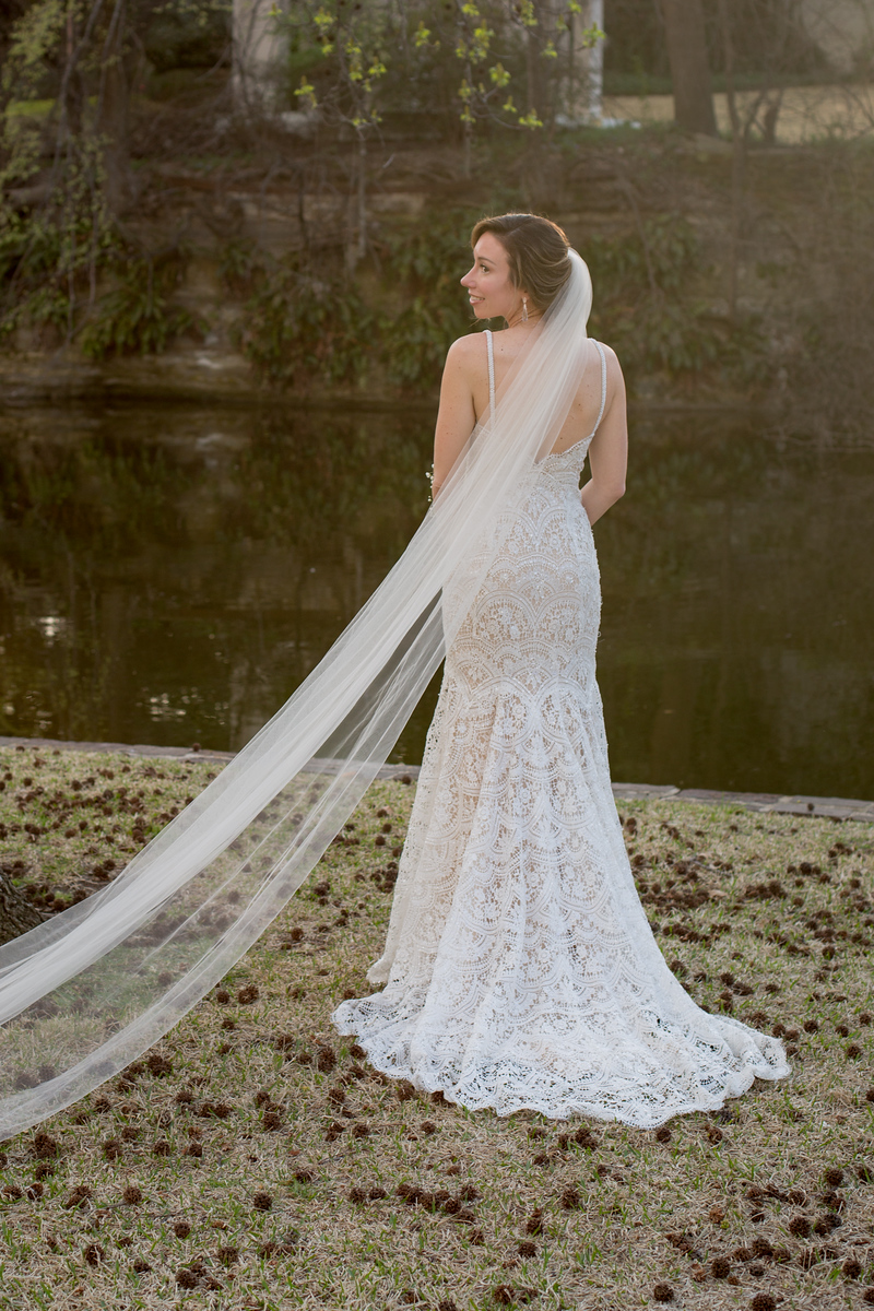 along vale train wedding dress photographed outdoor