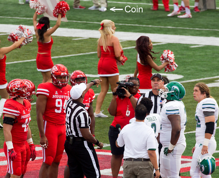 The coin toss.  Tulane wins -- elects to kickoff ...