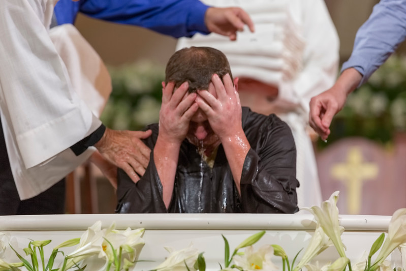 Man being baptized - full immersion three times