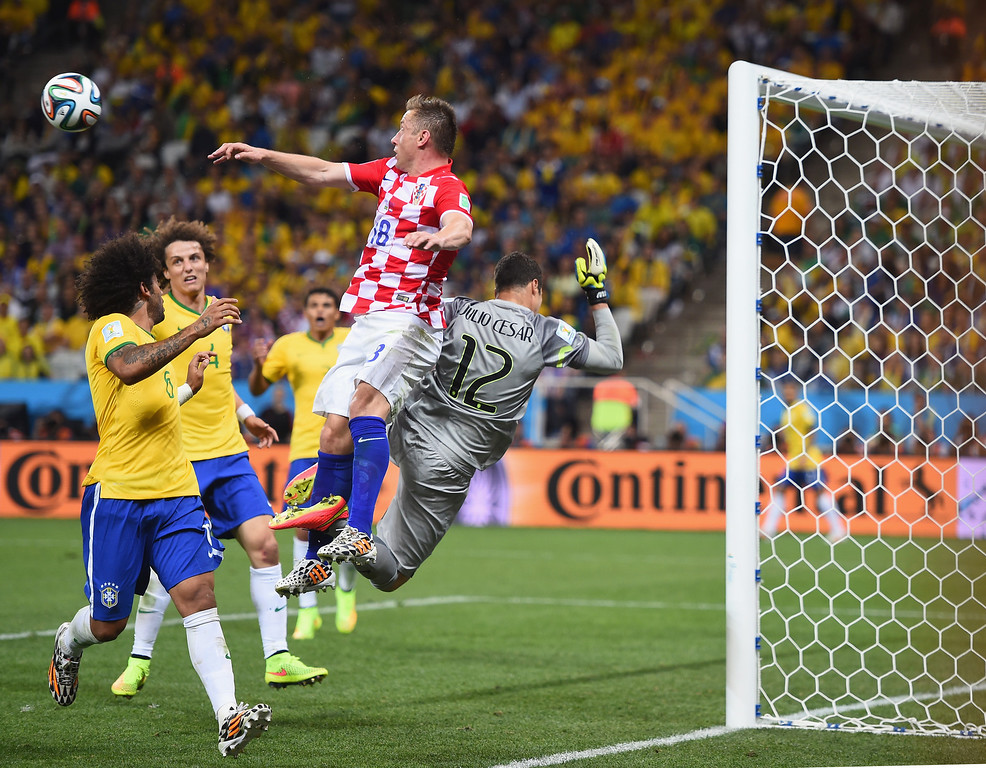 . Ivica Olic of Croatia challenges Julio Cesar of Brazil as he tries to make a save in the second half during the 2014 FIFA World Cup Brazil Group A match between Brazil and Croatia at Arena de Sao Paulo on June 12, 2014 in Sao Paulo, Brazil.  (Photo by Christopher Lee/Getty Images)