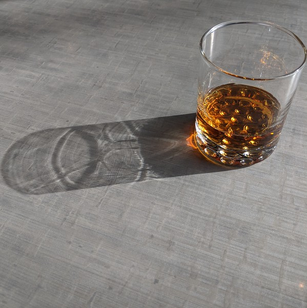 Whiskey and shadows at The Old Gold in Portland, OR.
