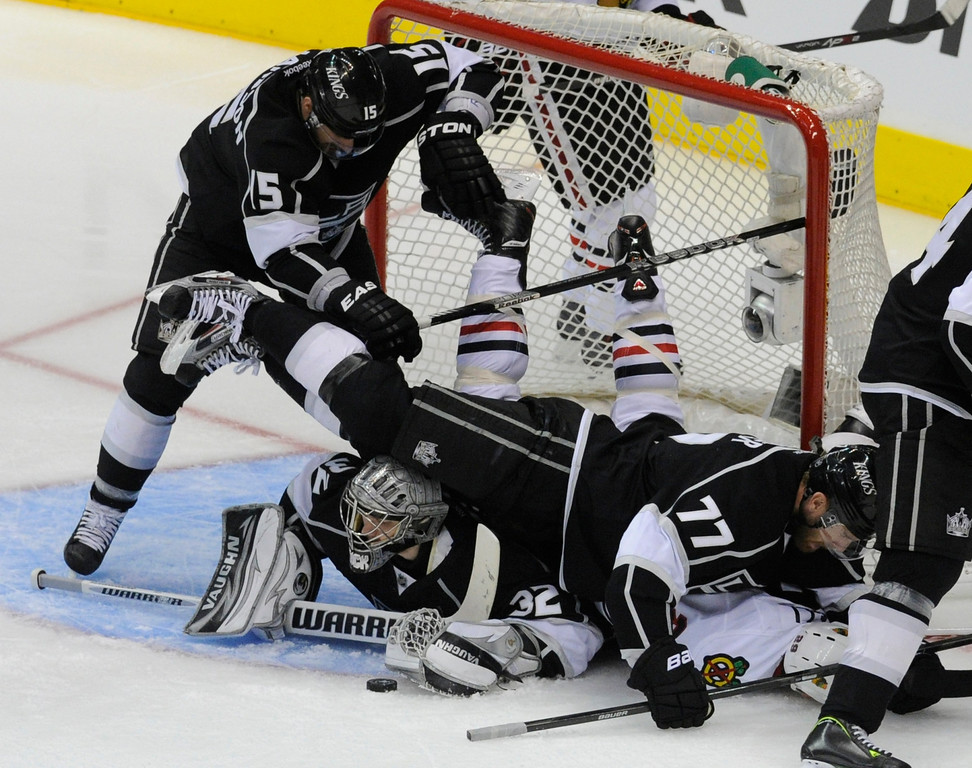 . Players from both sides get tangled up in front of the Kings goal in the 3rd period. The Kings defeated the Chicago Blackhawks in the 3-1 in the 3rd game of the Western Conference Finals. Los Angeles, CA 6/4/2013(John McCoy/LA Daily News4