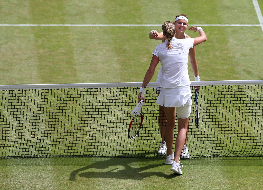 . Petra Kvitova of Czech Republic embraces Lucie Safarova of Czech Republic, right, after defeating her in their women\'s singles semifinal match at the All England Lawn Tennis Championships at Wimbledon, London, Thursday, July, 3, 2014. (AP Photo/Andrew Cowie, Pool)