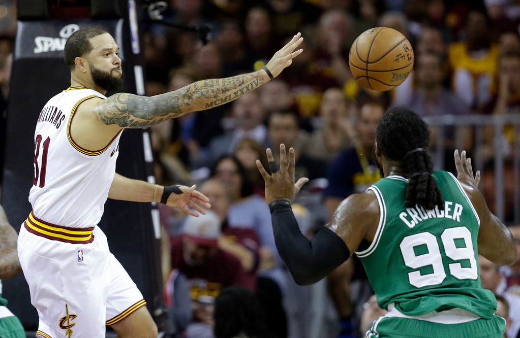 . Cleveland Cavaliers\' Deron Williams (31) passes against Boston Celtics\' Jae Crowder (99) during the first half of Game 4 of the NBA basketball Eastern Conference finals, Tuesday, May 23, 2017, in Cleveland. (AP Photo/Tony Dejak)