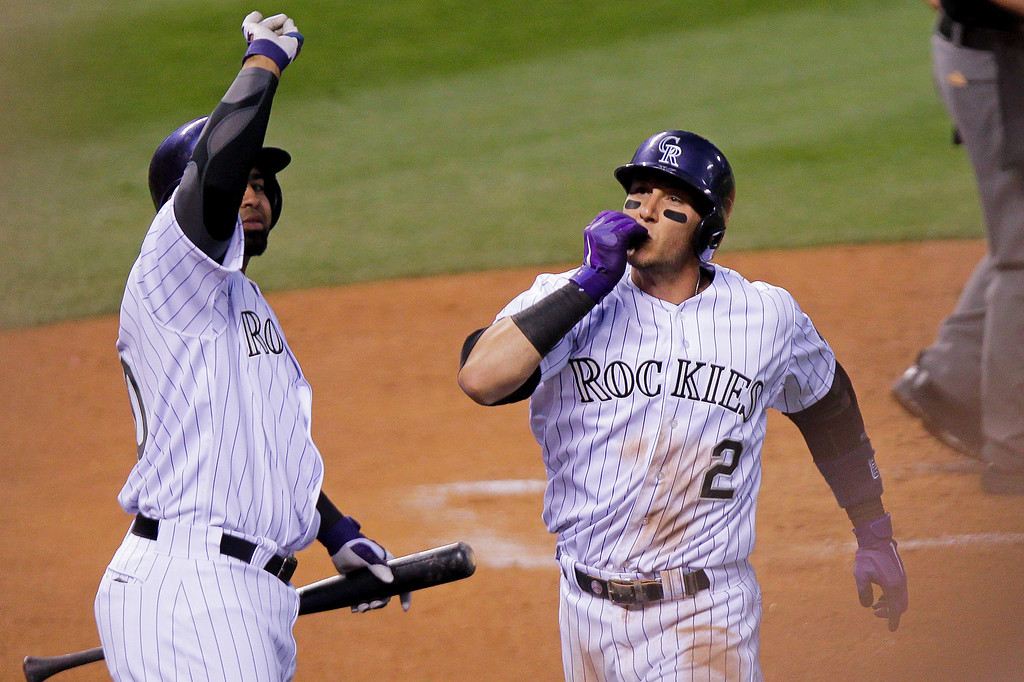 . Colorado Rockies\' Troy Tulowitzki (2) celebrates after hitting a home run off of San Francisco Giants\' Madison Bumgarner during the fourth inning of a baseball game, Tuesday, April 22, 2014, in Denver. (AP Photo/Barry Gutierrez)
