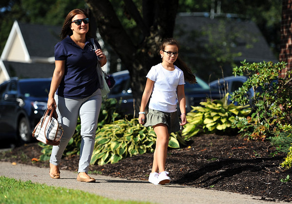8/29/2019 Mike Orazzi | Staff Gioena Borges and her daughter Bianca arrive at the Derynoski Elementary School on Southington's first day back this year.