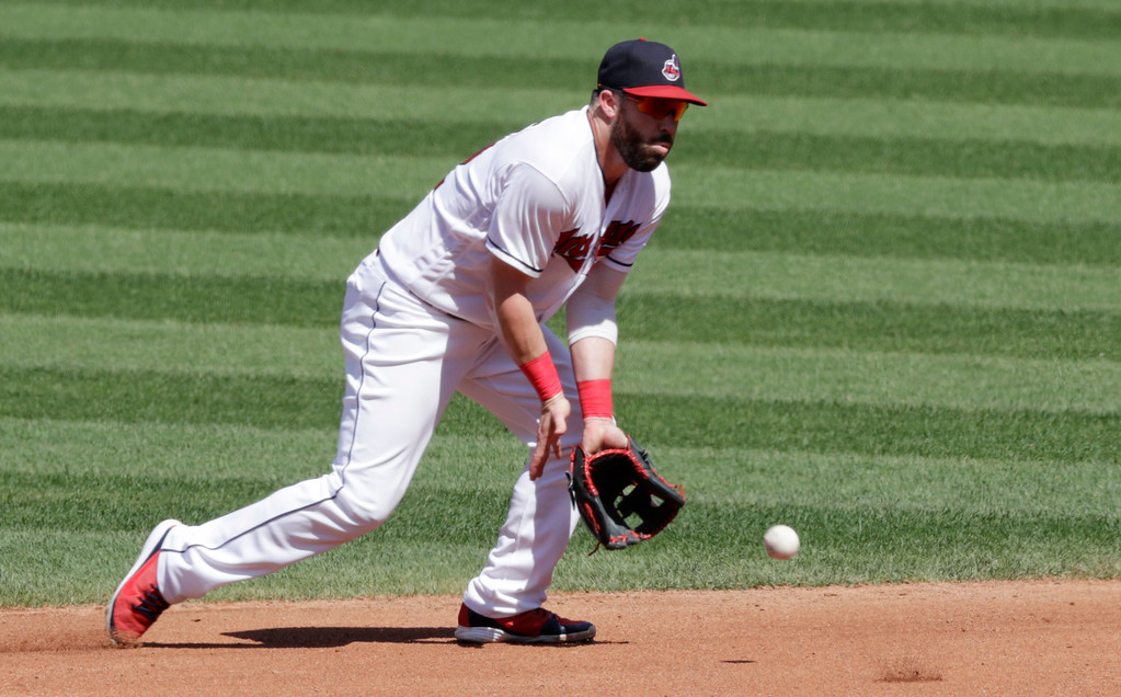 . Cleveland Indians\' Jason Kipnis fields a ball hit by Kansas City Royals\' Whit Merrifield in the fourth inning of a baseball game, Wednesday, Sept. 5, 2018, in Cleveland. Merrifield was out on the play. The Indians won 3-1. (AP Photo/Tony Dejak)