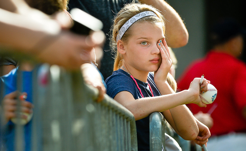 . After all that, 10-year old Jayden Hermanson of St. Cloud continues to wait and hope for Joe Mauer\'s autograph in the 84-degree heat. (Pioneer Press: Ben Garvin)