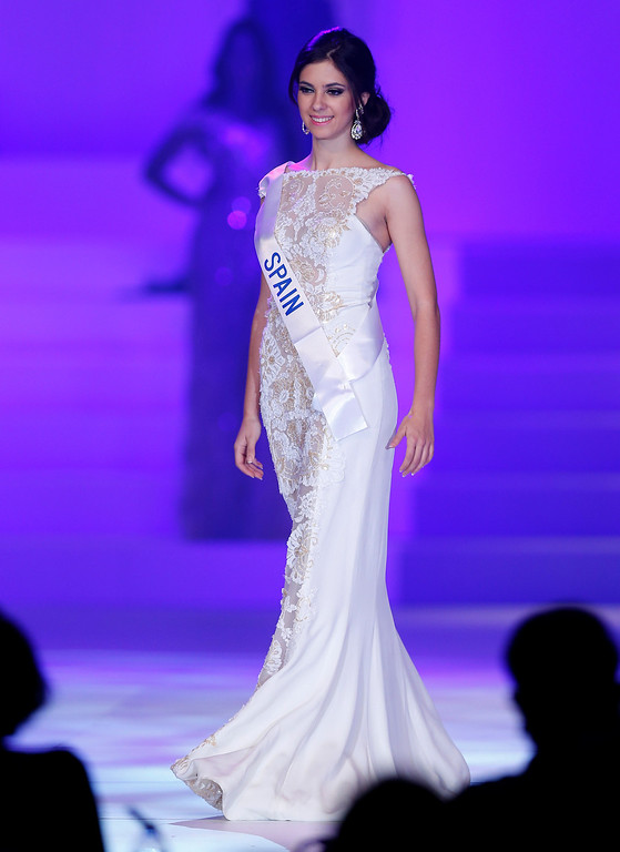. Miss Spain Araceli Carriero Martinez walks with a traditional costume during the final of the 53rd Miss International Beauty Pageant in Tokyo Tuesday, Dec. 17, 2013. (AP Photo/Shizuo Kambayashi)