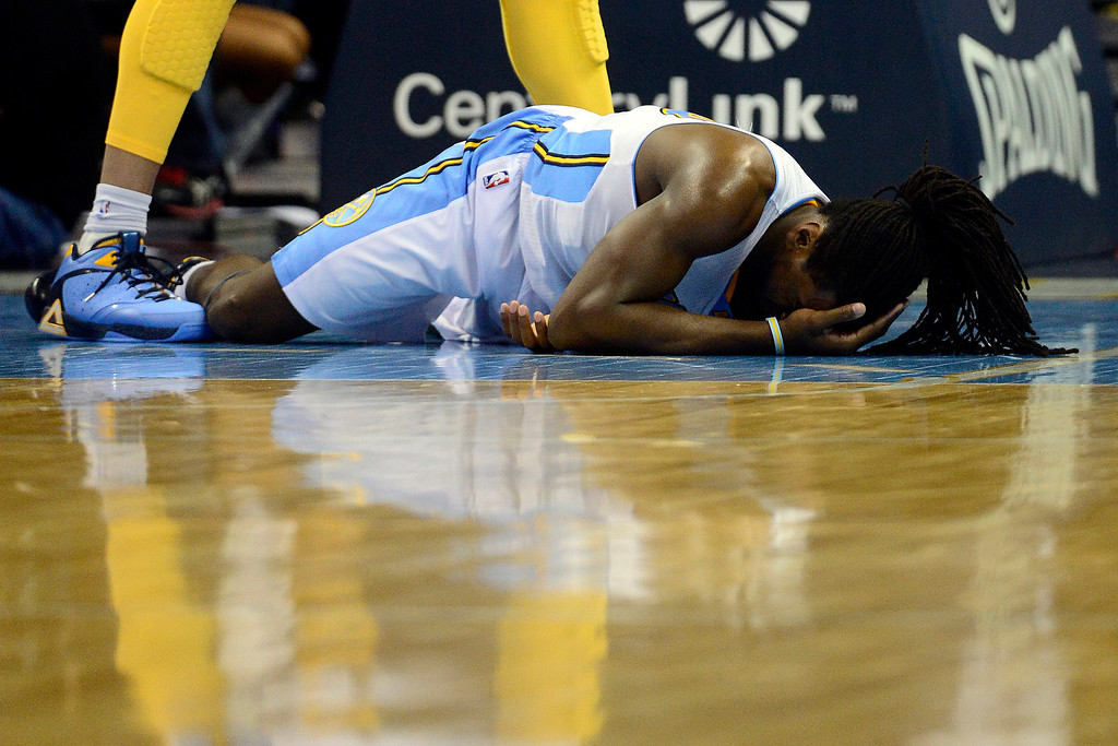 . Denver Nuggets small forward Kenneth Faried (35) hits the deck after colliding with Los Angeles Lakers center Dwight Howard (12) during the second half of the Nuggets\' 126-114 win at the Pepsi Center on Wednesday, December 26, 2012. Howard was ejected following the play. AAron Ontiveroz, The Denver Post