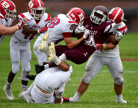 9/8/2018 Mike Orazzi | Staff Bulkeley/HMTCA/Weaver's Anthony Regis (4) stopped by the Berlin defense in Hartford Saturday.