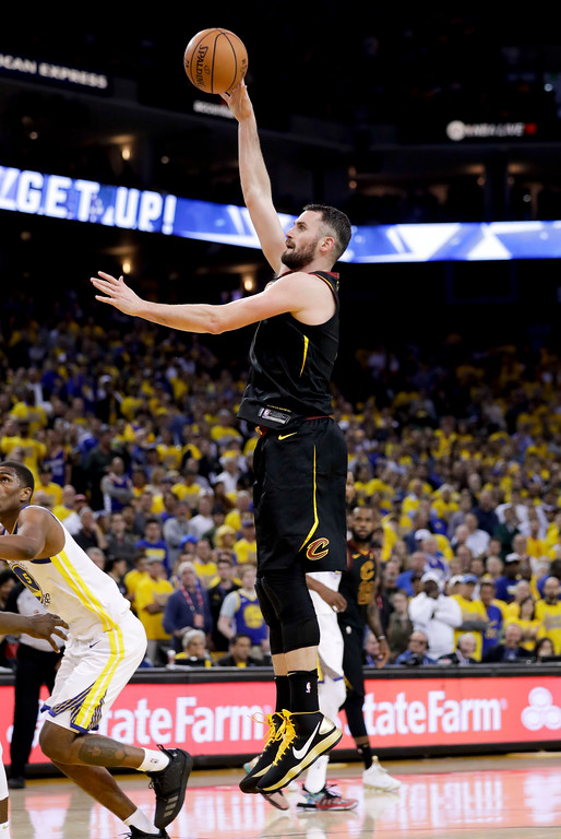 . Cleveland Cavaliers forward Kevin Love shoots against the Golden State Warriors during the second half of Game 1 of basketball\'s NBA Finals in Oakland, Calif., Thursday, May 31, 2018. (AP Photo/Marcio Jose Sanchez)