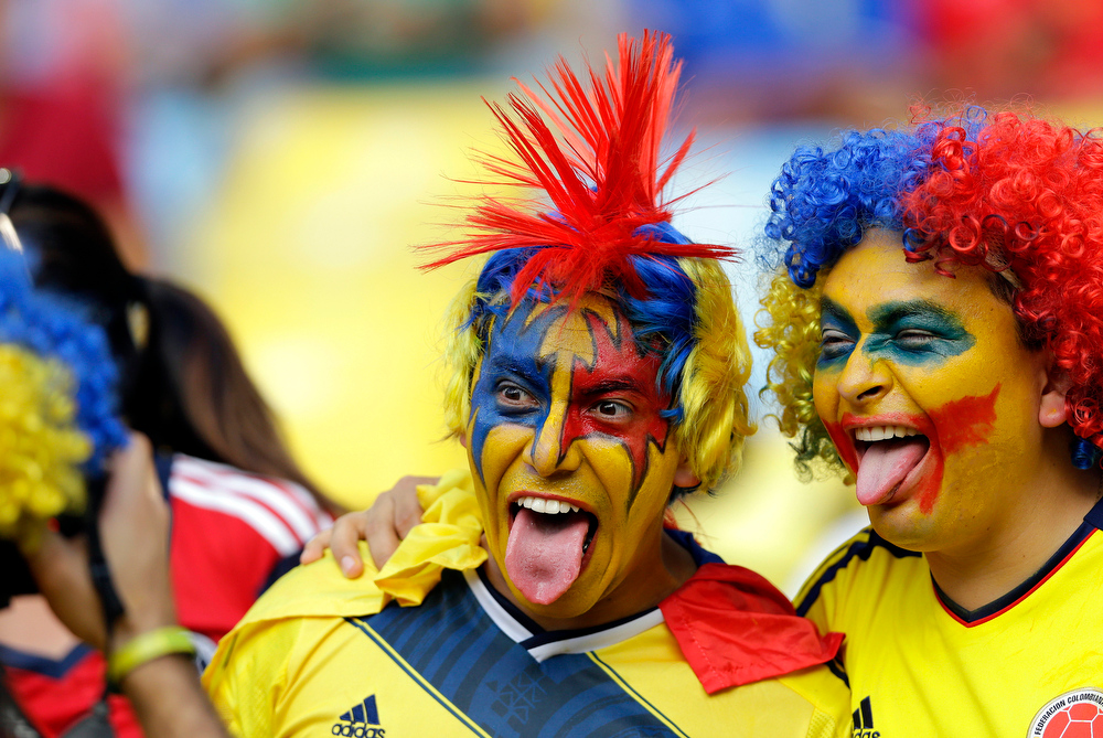 . Colombian fans have their picture taken before the World Cup round of 16 soccer match between Colombia and Uruguay at the Maracana Stadium in Rio de Janeiro, Brazil, Saturday, June 28, 2014. (AP Photo/Antonio Calanni)