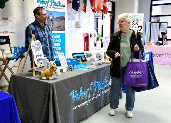 3/9/2019 Mike Orazzi | Staff Woof Pack's Bob Carbonell talks with Germaine Lombardi during The Central Connecticut Chambers of Commerce's Family Health & Wellness Expo held Saturday at Bristol Eastern High School.
