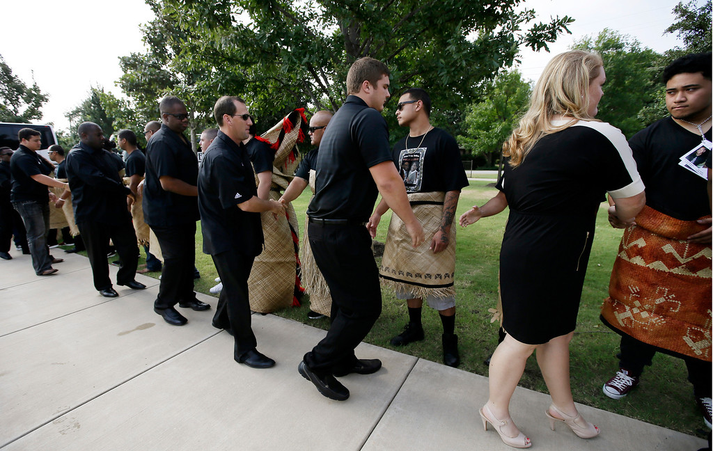 ". Members of the Texas A&M football team and staff are greeted by a receiving line at the Church of Jesus Christ Of Latter Day Saints before a funeral service for redshirt freshman Polo Manukainiu and his brother Andrew Uhatafe, Saturday, Aug. 10, 2013, in Colleyville, Texas. The two were killed in a single car accident in Northern New Mexico, July 29. Also killed was 18-year-old Utah recruit Gaius ""Keio\"" Vaenuku. (AP Photo/Tony Gutierrez)"