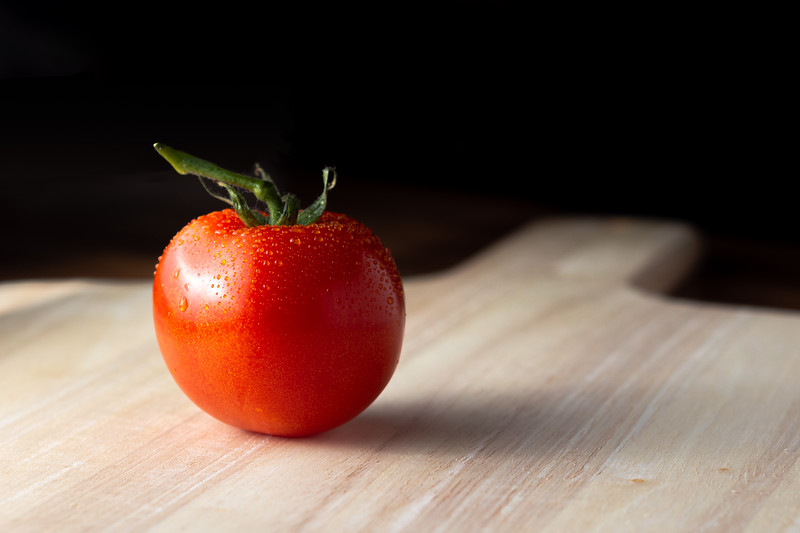 Tomato on a wooden board