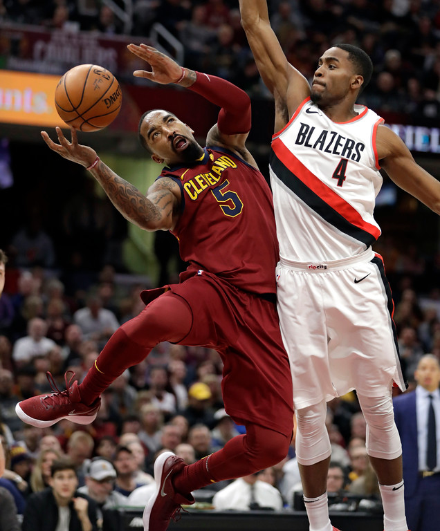 . Cleveland Cavaliers\' JR Smith (5) is fouled by Portland Trail Blazers\' Maurice Harkless (4) in the second half of an NBA basketball game, Tuesday, Jan. 2, 2018, in Cleveland. The Cavaliers won 127-110. (AP Photo/Tony Dejak)
