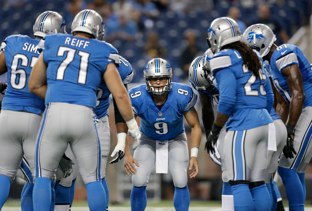 . Detroit Lions quarterback Matthew Stafford (9) huddles the offense during warmups for a NFL football game against the Jacksonville Jaguars in Detroit, Friday, Aug. 22, 2014.  (AP Photo/Paul Sancya)