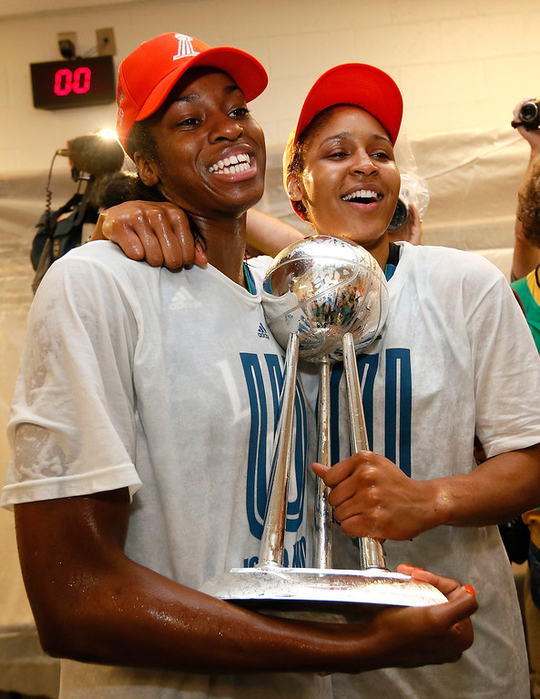. ATLANTA, GA - OCTOBER 10:  Devereaux Peters #14 and Maya Moore #23 of the Minnesota Lynx celebrate with the trophy after their 86-77 win over the Atlanta Dream in Game Three of the 2013 WNBA Finals at Philips Arena on October 10, 2013 in Atlanta, Georgia.   (Photo by Kevin C. Cox/Getty Images)