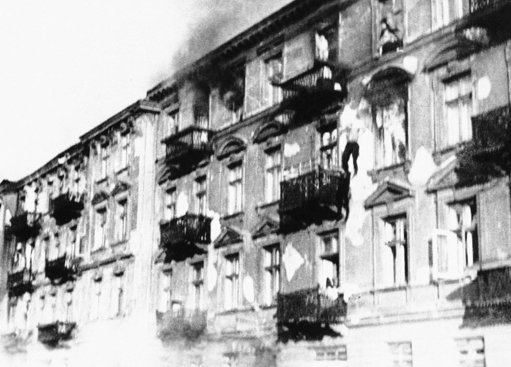 . A man is shown as he jumped from a window of a building in the Warsaw ghetto, in 1943, during the destruction of the ghetto by the Nazis. (AP Photo)