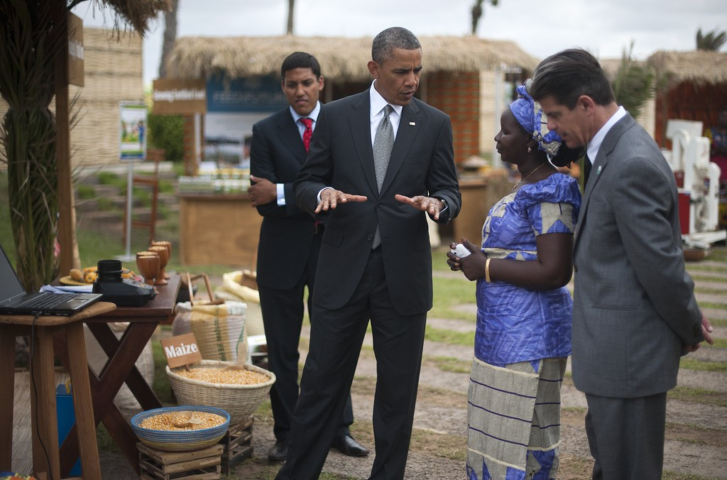 . US President Barack Obama (2nd L) speaks on June 28, 2013 with the head of the Senegalese Federation of Corn Producers, Nimna Diayte (2nd R), before USAID administrator Raj Shah (L) during an event on food security in Dakar. Obama flies to South Africa later on June 27 to pay homage to his former President Nelson Mandela, who is fighting for his life in hospital. JIM WATSON/AFP/Getty Images