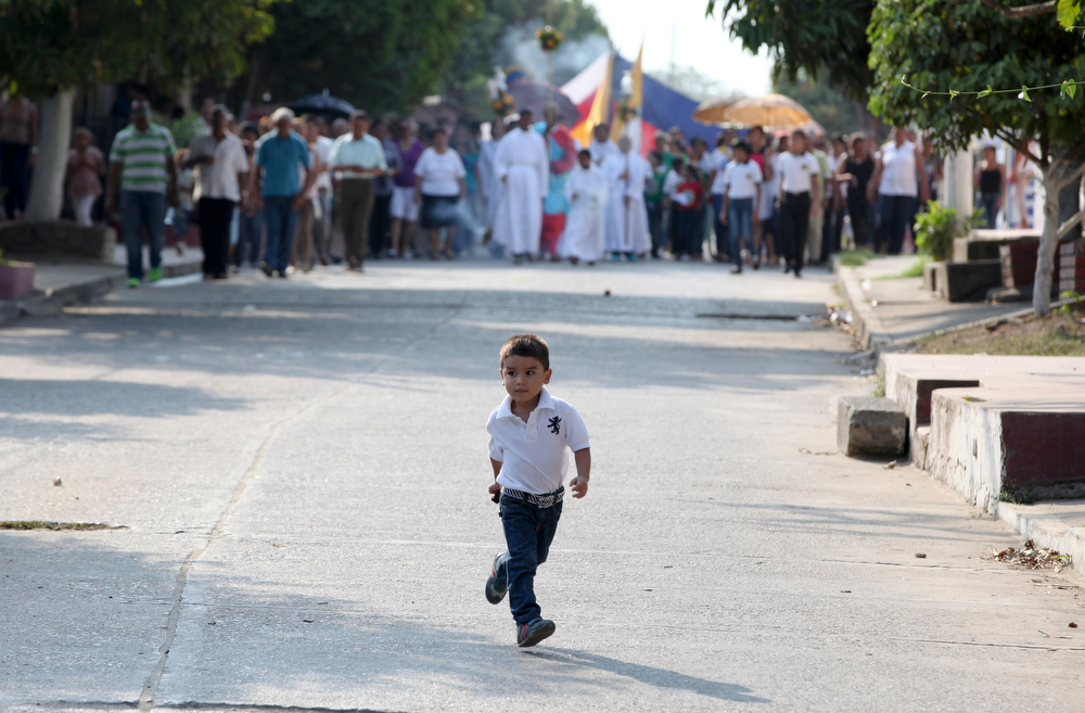 . A boy runs ahead a Good Friday precession in Aracataca, the hometown of late Nobel laureate Gabriel Garcia Marquez in Colombia\'s Caribbean coast, Friday, April 18, 2014. (AP Photo/Ricardo Mazalan)