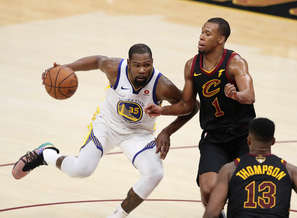. Golden State Warriors\' Kevin Durant goes to the basket against Cleveland Cavaliers\' Rodney Hood in the second half of Game 3 of basketball\'s NBA Finals, Wednesday, June 6, 2018, in Cleveland. The Warriors defeated the Cavaliers 110-102 to take a 3-0 lead in the series. (AP Photo/Carlos Osorio)