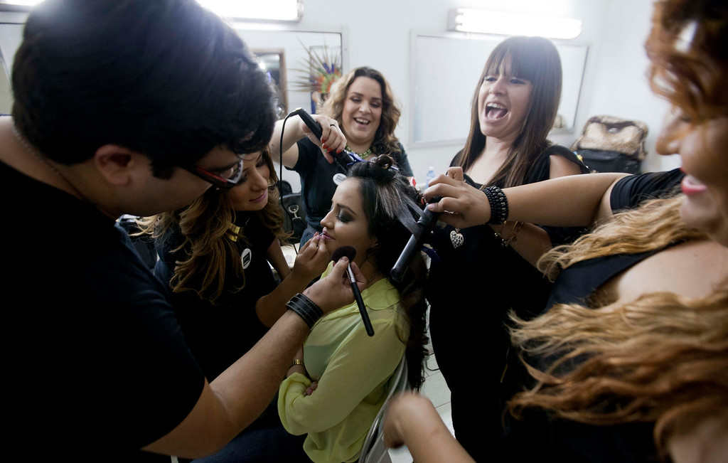 ". In this Jan. 26, 2013 photo, Magdabelyn Parra Gamez, who goes by Belyn, holds still for her make-up backstage before competing in the ""Guamuchil Carnival Queen 2013\"" beauty pageant in Guamuchil, Sinaloa state, Mexico.  Belyn, 18, took up the mantle on the pageant circuit after the death of her cousin beauty queen Maria Susana Flores Gamez, who in November 2012 died like a mobster\'s moll, carrying an AK-47 assault rifle into a spray of gunfire from Mexican soldiers. \""This is in memory of Susy,\"" Belyn whispered, shortly before winning the crown, \""In honor of her.\"" (AP Photo/Eduardo Verdugo)"