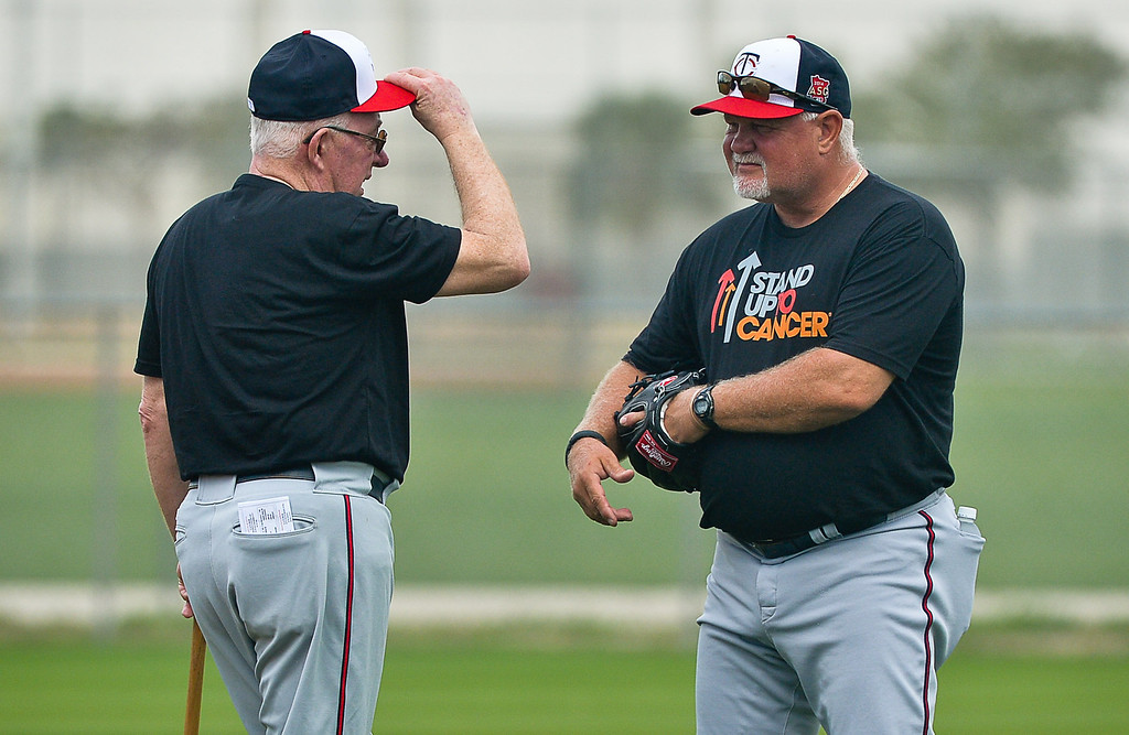 . Twins manager Ron Gardenhire, right, chats with former manager Tom Kelly who arrived for his first day at camp Saturday. (Pioneer Press: Ben Garvin)
