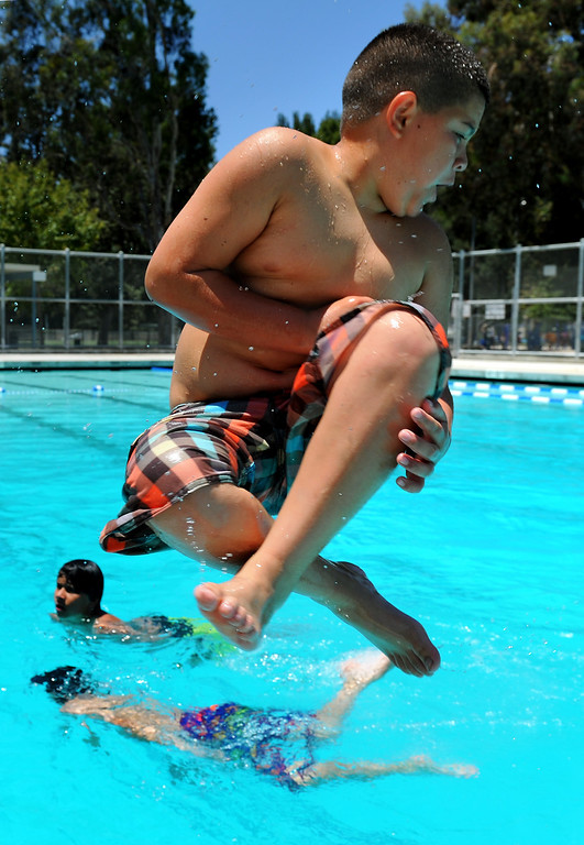 . Danny Delgado, 10, does a spinning cannonball at the Lanark Park pool in Canoga Park, Saturday, June 14, 2014. (Photo by Michael Owen Baker/Los Angeles Daily News)