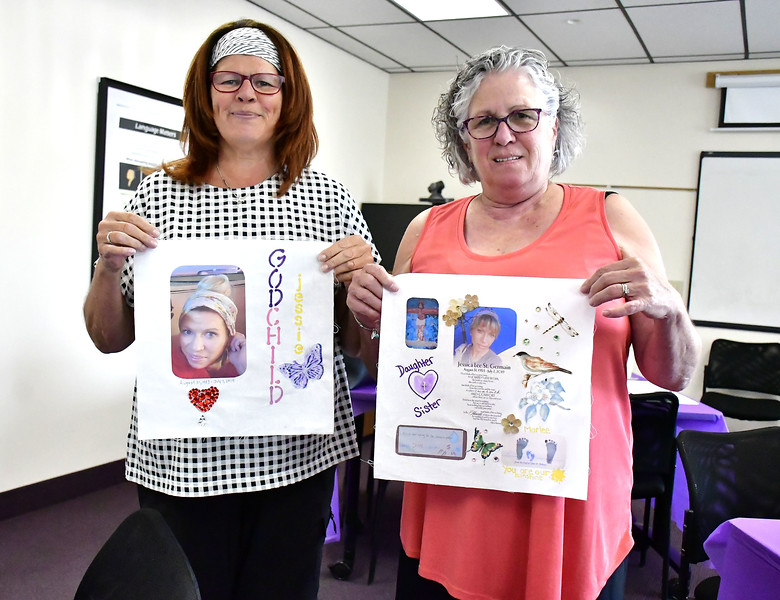 8/31/2019 Mike Orazzi | Staff Robin Cowles and Holly McGloin hold completed squares in honor of Jessica Lee St. Germain made during a Remembrance Quilt Square making event at Connecticut Clearinghouse on Farmington Avenue in Plainville on Saturday. Cowles is Jessica's god mother and McGloin is her mom. McGloin received help making the sqaure from her other daughter June Sheehan.