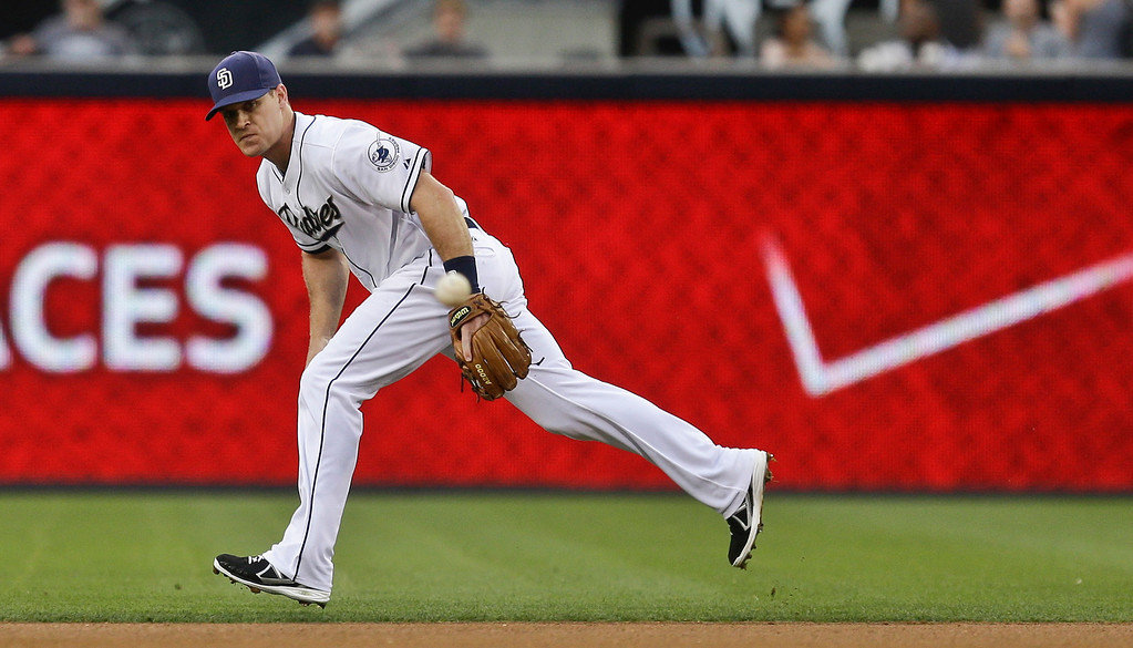 . San Diego Padres second baseman Logan Forsythe eyes a hard-hit drive by Colorado Rockies\' DJ LeMahieu that got past him for a single in the first inning of a baseball game in San Diego, Wednesday, July 10, 2013. (AP Photo/Lenny Ignelzi)