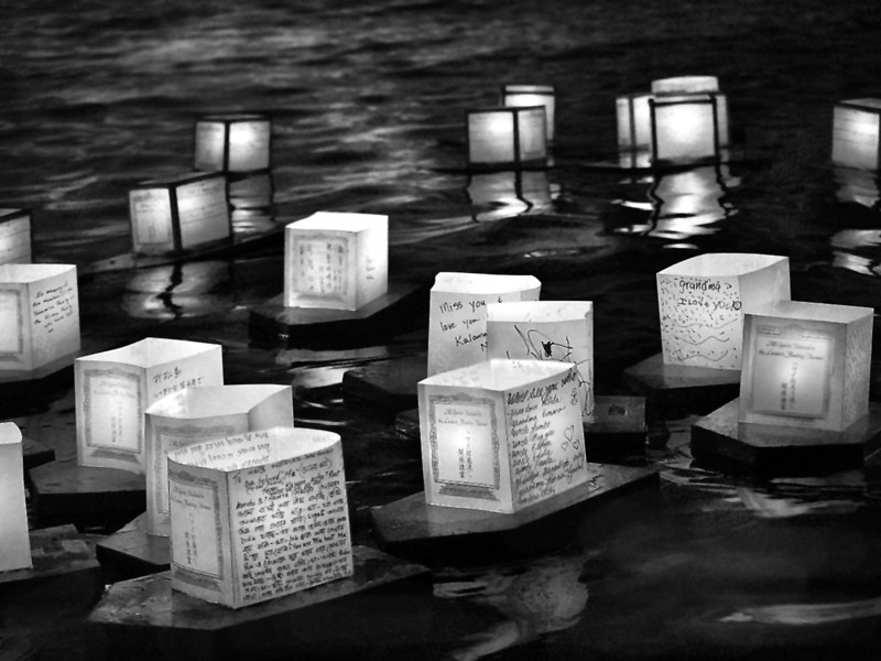Lanterns with hand written messages honoring the deceased set into the ocean. Honolulu, Hawaii
