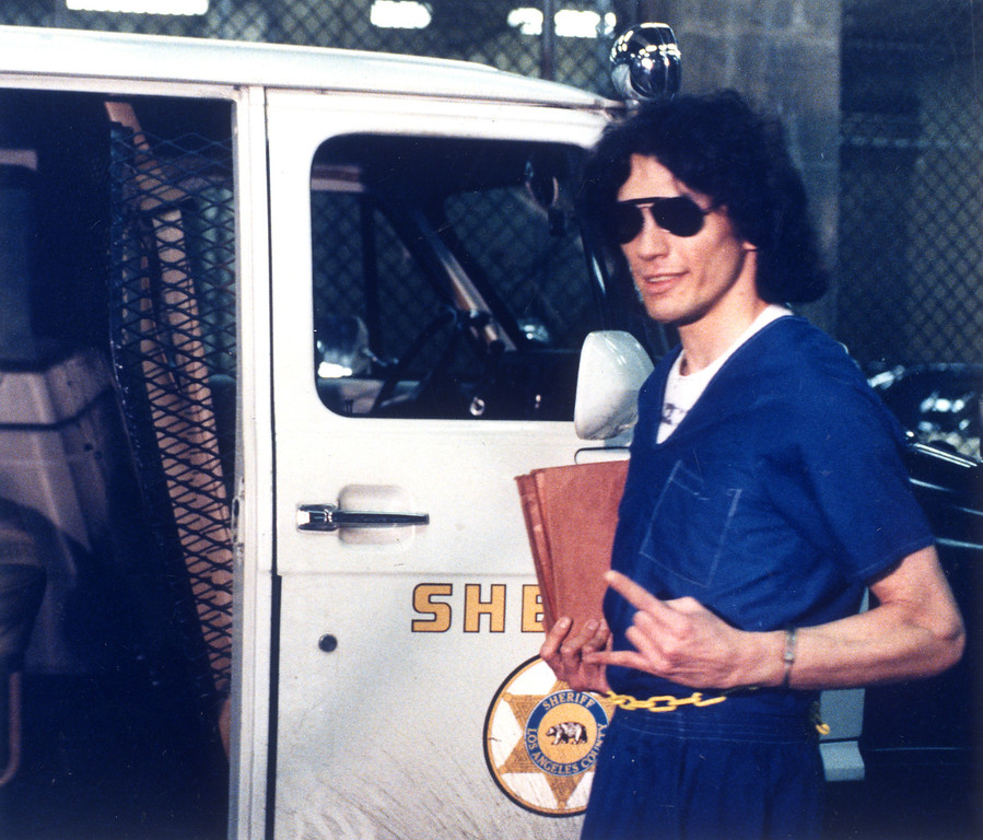 """. Richard Ramirez flashes a \""""devil sign\"""" in reaction to his conviction on 43 felony counts.  (Daily News file photo)"""
