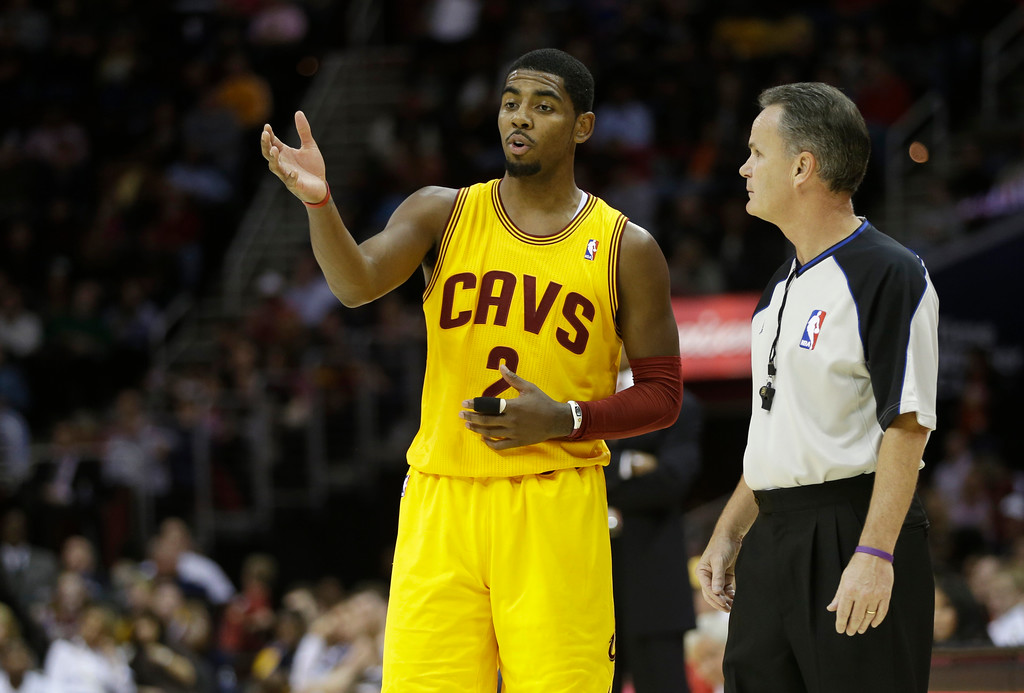 . Cleveland Cavaliers\' Kyrie Irving (2) talks with referee Mike Callahan during an NBA basketball game against the Dallas Mavericks Saturday, Nov. 17, 2012, in Cleveland. (AP Photo/Mark Duncan)