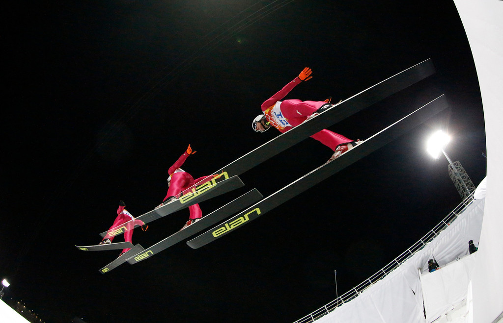 . In this multiple exposure photo taken with a fisheye lens Poland\'s Dawid Kubacki makes his trial jump during the men\'s normal hill ski jumping final at the 2014 Winter Olympics, Sunday, Feb. 9, 2014, in Krasnaya Polyana, Russia. (AP Photo/Dmitry Lovetsky)