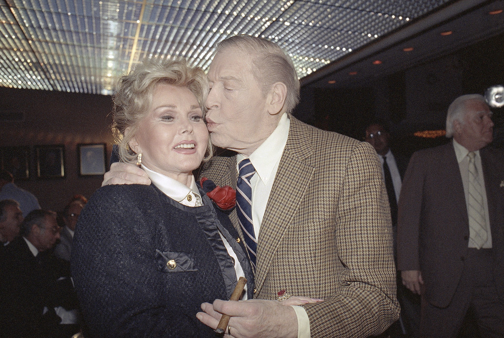 . Milton Berle plants a kiss on the cheek of Zsa Zsa Gabor in Los Angeles on Thursday, Jan. 25, 1990 during news conference where Berle announced that Ms. Gabor would be honored with a Stag Roast on May 14,1990.     (AP Photo/ Nick Ut)