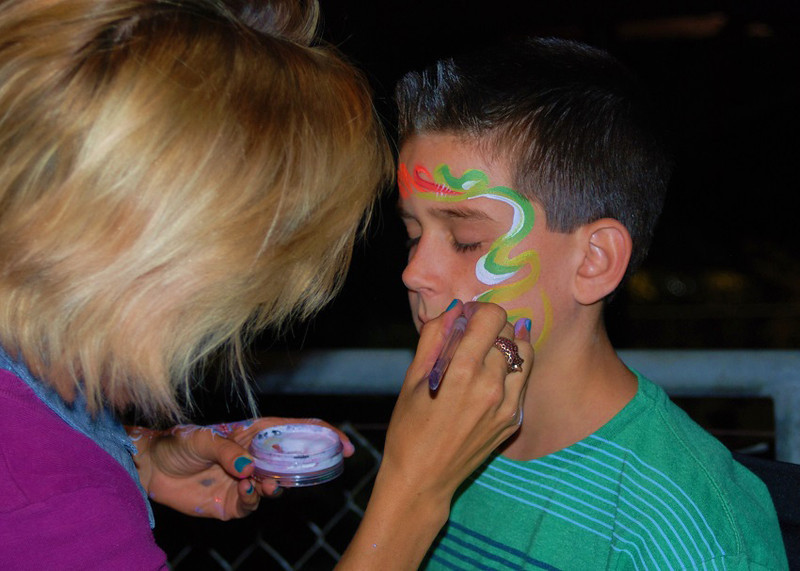 . Youngster at the Greater Los Angeles Zoo Association\'s Sunset Safari gets a special face painting by a Paint on Your Face artist.  (Photo by Michaelyn Straub for the Daily News)