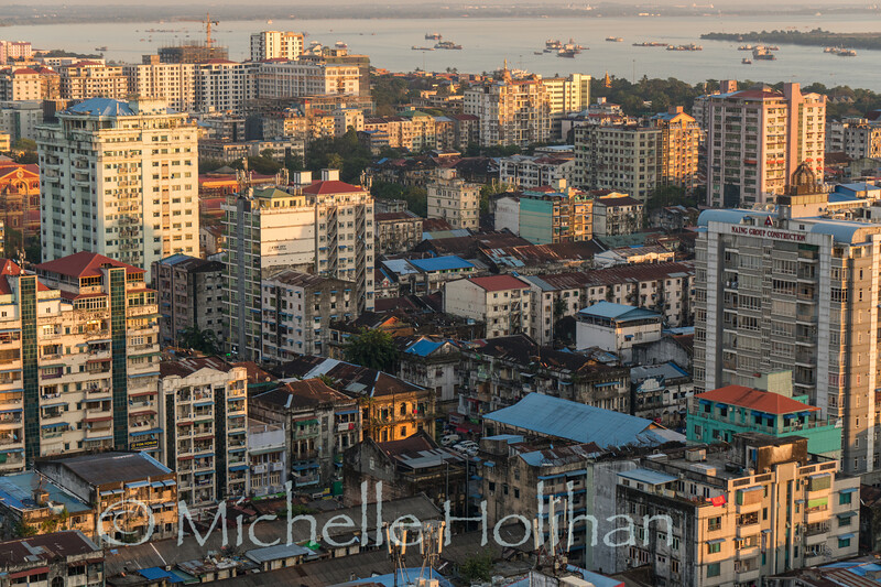 YANGON, MYANMAR - DECEMBER 16, 2018: The sun sets on downtown Yangon.