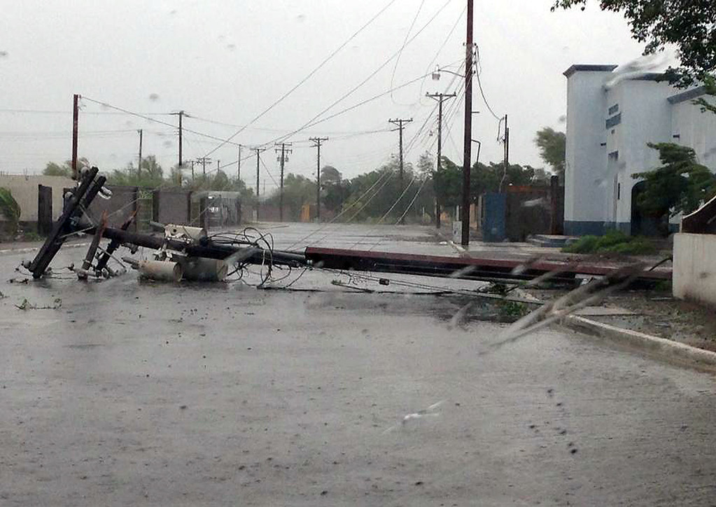 . A fallen utility post blocks a road as see through the windshield of a car in the city of Loreto, Mexico, Monday Sept. 15, 2014. Hurricane Odile blazed a trail of destruction through Mexico\'s Baja California Peninsula on Monday that leveled everything from ramshackle homes to luxury hotels and big box stores, leaving entire neighborhoods as disaster zones. (AP Photo/Fernando Lopez Pineda)