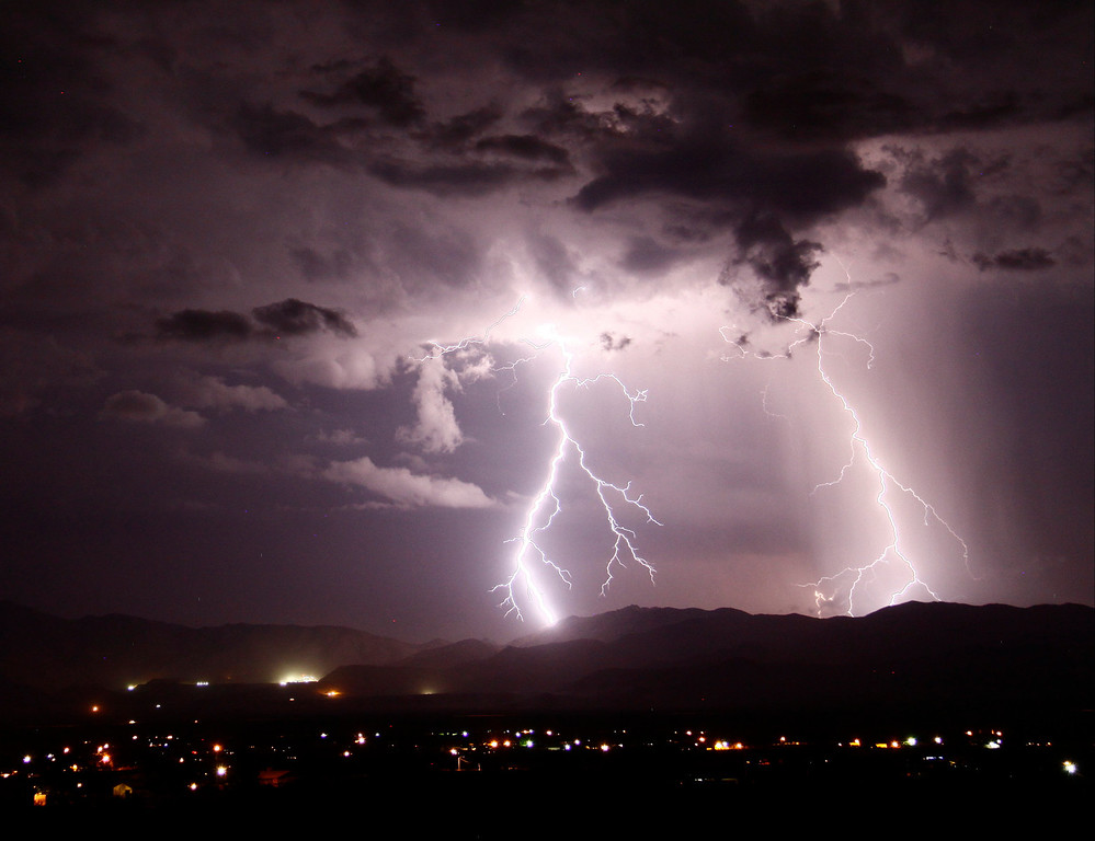 . Lightning strikes across the skies  Saturday evening into early Sunday morning  over Needles CA, July 20. This monsoon storms the last two days has causes some major flooding and power outage in Las Vegas areas. July 20, ,2013. Photo by Gene Blevins/LA DailyNews