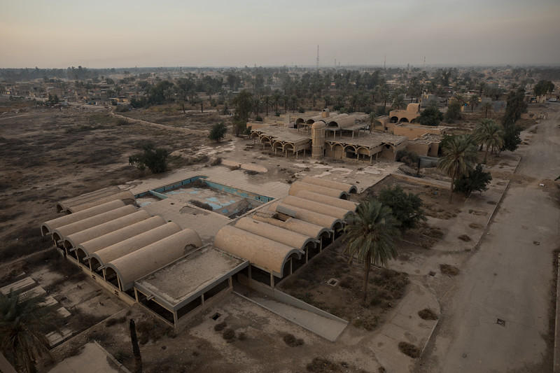 Looking down on a swimming pool and relaxation area for Baathist Party members.