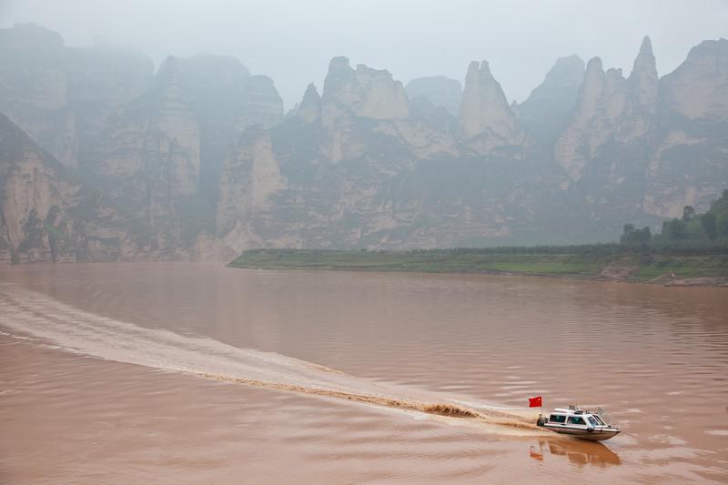 Speed boat on Yellow River near Bingling Si, Gansu Province, China
