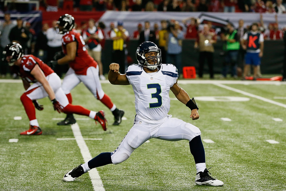 . Russell Wilson #3 of the Seattle Seahawks celebrates a fourth quarter touchdown against the Atlanta Falcons during the NFC Divisional Playoff Game at Georgia Dome on January 13, 2013 in Atlanta, Georgia.  (Photo by Kevin C. Cox/Getty Images)